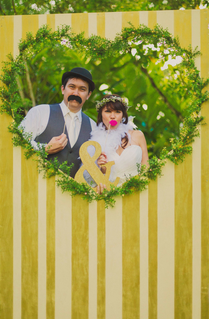 DIY-whimsical-wedding-in-Hawaii-with-photo-booth-backdrops-heart-yellow-stripes
